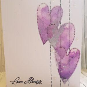 Purple hearts love greeting card